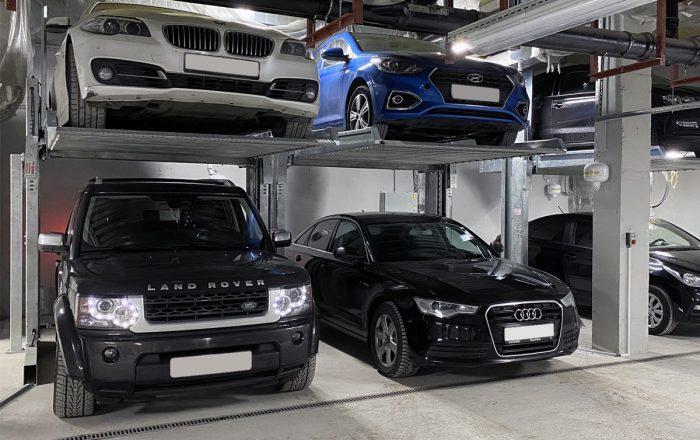 Двухуровневые парковочные подъёмники в подземном паркинге