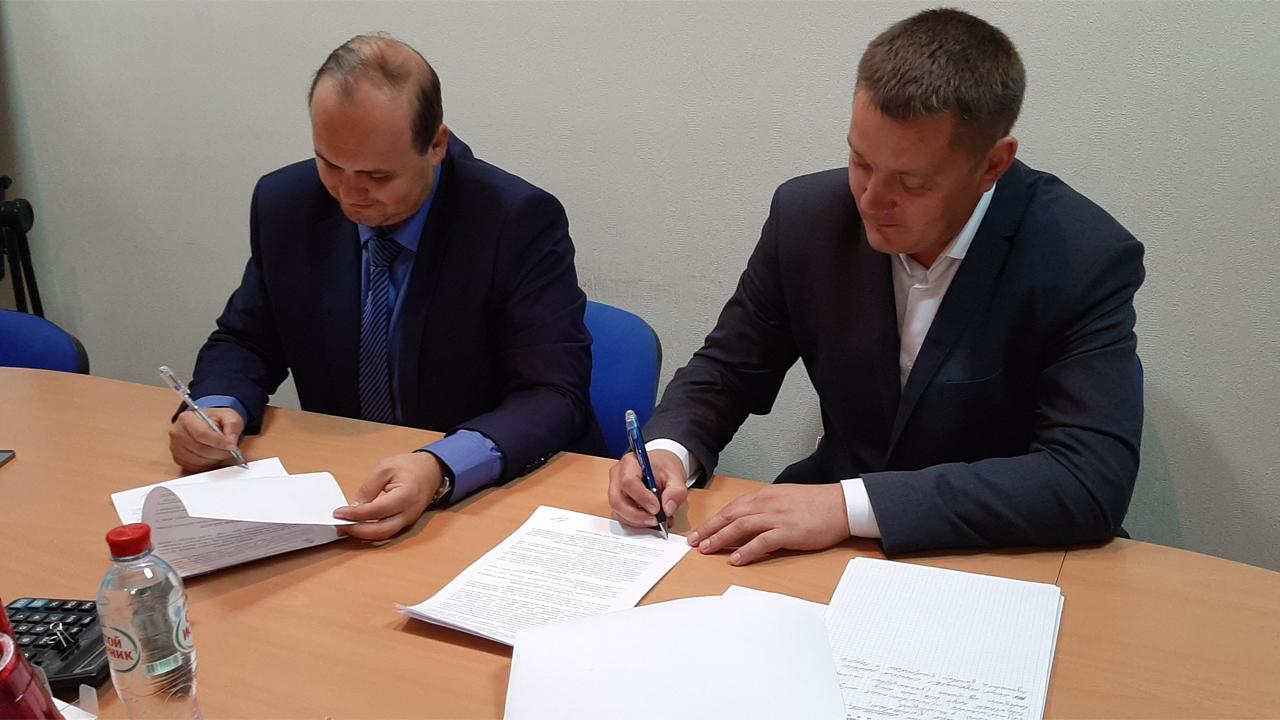 Подписание дилерского договора с заводом вертикальных роторных и башенных парковок