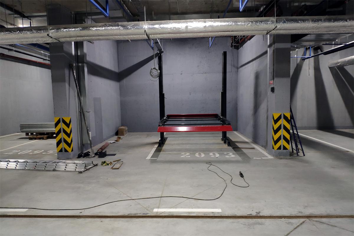 Монтаж парковочных подъёмников в подземном паркинге
